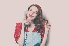 Woman with retro phone Royalty Free Stock Images