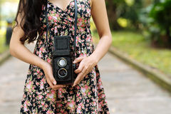 Woman with retro photo camera Stock Photos