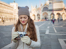 Woman with retro photo camera standing on Piazza San Marco Stock Photos