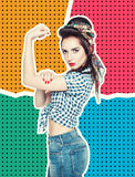 Woman in retro pin-up style with powerful gesture We Can Do IT. On halftone background Royalty Free Stock Photos