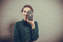 Woman retro style with old camera Stock Photography