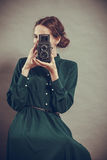 Woman retro style with old camera Royalty Free Stock Images