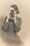 Woman retro style with old camera Stock Images