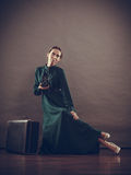 Woman retro style with old suitcase camera Royalty Free Stock Images