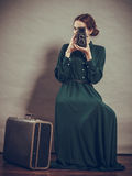 Woman retro style with old suitcase camera Stock Image