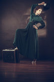 Woman retro style with old suitcase and fan Stock Photo