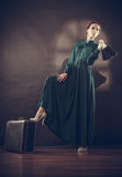 Woman retro style with old suitcase and fan Stock Photos