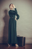 Woman retro style with old suitcase Royalty Free Stock Photos