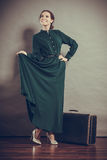 Woman retro style with old suitcase Stock Photos