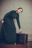 Woman retro style with old suitcase Royalty Free Stock Photography