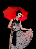 Woman in retro styled dress with red umbrella Stock Images