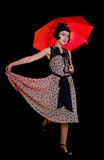Woman in retro styled dress with red umbrella Royalty Free Stock Photography