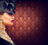 Woman with Retro Styled Hairstyle and Makeup royalty free stock image