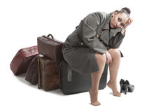 Woman with retro suitcases. Beautiful young woman with retro style suitcases in military greatcoat Stock Image