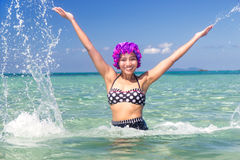 Woman in retro swimsuit splash water Royalty Free Stock Photo