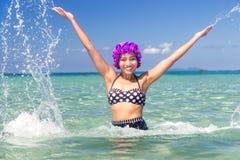 Woman in retro swimsuit splash water Royalty Free Stock Photo