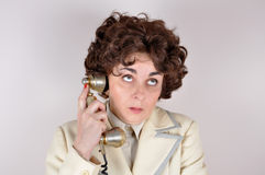 Woman on the retro telephone Stock Photo