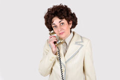 Woman on the retro telephone Royalty Free Stock Photography