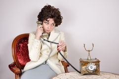 Woman on the retro telephone Royalty Free Stock Photos