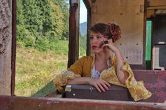 Woman in a retro train near the window royalty free stock photography