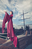 Woman in retro vintage clothes on boat Royalty Free Stock Photography