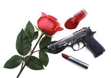 Woman revenge. Set of fresh rose, gun and cosmetic isolated royalty free stock photography