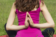 Woman in reverse namaste pose Stock Photography