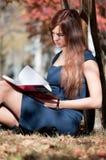 Woman reviewing diary at city park Royalty Free Stock Photo