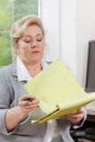 Woman reviewing notes Stock Image