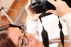 Woman reviewing Photos Stock Photo