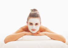 Woman with revitalising mask on face laying on massage table Royalty Free Stock Photography
