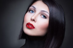 Woman with rhinestones on her lips Stock Photography