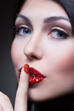 Woman with rhinestones on her lips and nails Royalty Free Stock Photos