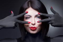 Woman with rhinestones on her lips and nails Stock Photos