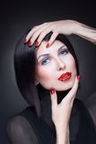 Woman with rhinestones on her lips and nails Royalty Free Stock Photo