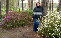 Woman and rhododendrons royalty free stock images