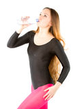 Woman in rhythmic gymnastics drinking water Stock Photography