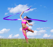 Woman with a ribbon. Happy dancing young woman with a ribbon outdoor on a summer day Royalty Free Stock Photos