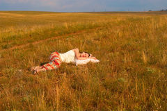 Woman with ribbons sleep in the  meadow Stock Photos