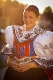 Woman in a richly decorated ceremonial folk dress Royalty Free Stock Images