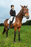 Woman ridding horse Stock Photography