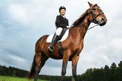 Woman ridding horse Royalty Free Stock Photo