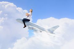 Woman ride airplane Stock Photo