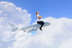 Woman ride airplane Stock Photography
