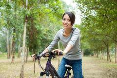 Woman ride a bicycle Stock Images