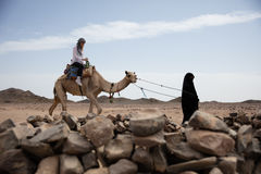 Woman ride in camel desert location Royalty Free Stock Photo