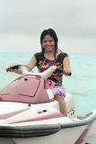 Woman ride Jetski Stock Photo
