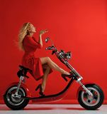 Woman ride new electric car motorcycle bicycle scooter present for new year 2019 in red dress blow kiss sign with lips on red. Background surprised stock photos