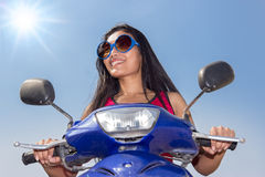 Woman ride on a scooter Stock Photos