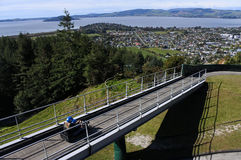 Woman ride on Skyline Rotorua Luge Royalty Free Stock Images